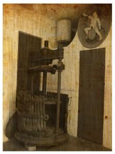 Antiga premsadora de gàbia en les instal·lacions de Destil·leries Plà.